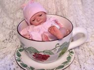 Baby Girl in a Big Cup