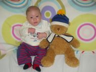 Cute and Cuddly Baby with Teddy
