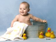 Cute Baby Bathing with Ducks