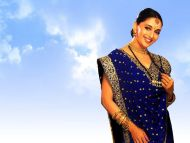Madhuri Dixit Madhuri Dixit Background is Currently 3.14/5; No Vote No Vote