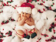 Sweet Baby Dressed Up As Santa Claus